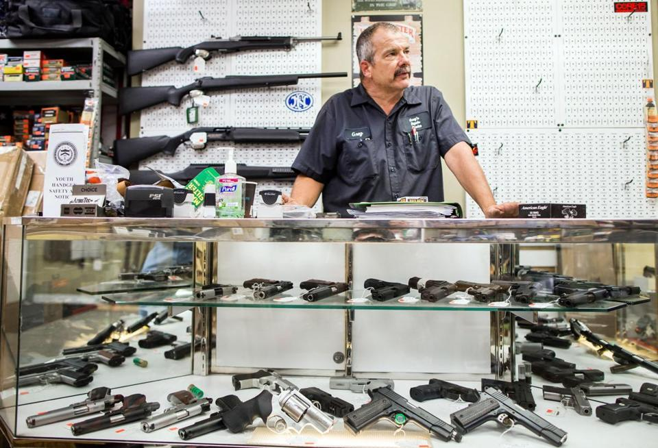 Owner Greg Malany helped customers at GFA Arms Tec in Natick.